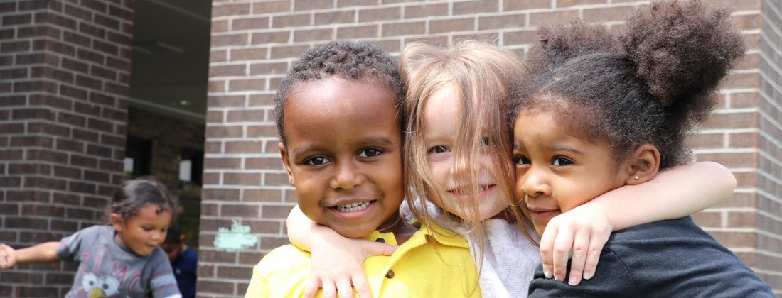 Group of children hugging and smiling